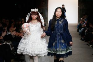 NEW YORK, NY - FEBRUARY 15: Model Misako Aoki and designer Fan Shumin walks the Soufflesong runway at Nolcha shows during New York Fashion Week Women's Fall/Winter 2016 presented by Neogrid at ArtBeam on February 15, 2016 in New York City. (Photo by Brian Ach/Getty Images For Nolcha) *** Local Caption *** Misako Aoki